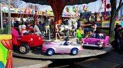 Children on fairytale carousel which turns around in funfair Stock Footage