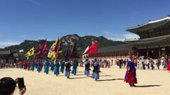 Palace guards in traditional Korean dresses in Gyeongbokgung Palace, Seoul Stock Footage