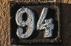 Old retro cast iron plate number 94 - stock photo