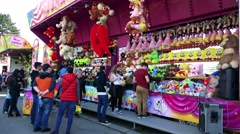 People in front of stand with souvenir and plush toys and choose Stock Footage