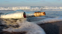 Message in a Bottle on the seashore, Slow Motion Stock Footage