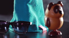 Winter fashion/Knitted hat and sunglasses/Blue woolen knitted cap - stock footage