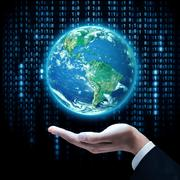 Businessman hand holding earth planet. Elements of this image are furnished by Stock Photos