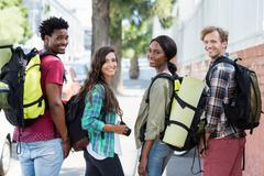 Friends standing with rucksack Stock Photos