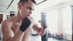Boxer hitting the punching bag Stock Footage