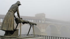 Medium shot of laundress statue in the fog in Pavia, PV, Italy Stock Footage