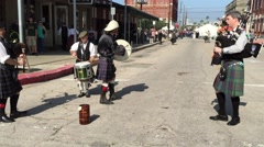 Scottish musicians play harp at Dickens on the Strand Festival in Galveston Stock Footage