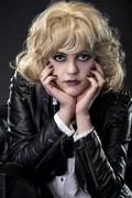 Black Nails on Goth Female Rocker Stock Photos