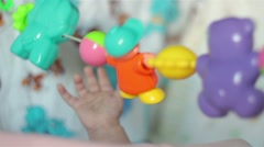 Baby's hand playing with toy Stock Footage