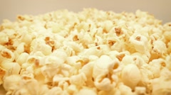 Golden Popcorn Rotating Slowly In Bowl Stock Footage