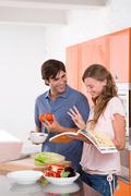 A couple reading a cookbook Stock Photos