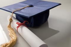 Scroll and mortarboard Stock Photos