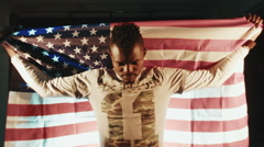 African American young man holding American flag - stock footage