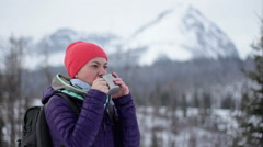Young woman drinking tea or coffee from a thermos cup in the mountains HD Stock Footage