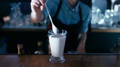Barista serving a milk shake. 60 FPS slow motion shot Stock Footage