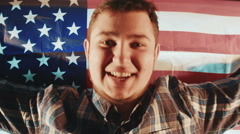 Latinos American caucasian male with American flag - stock footage