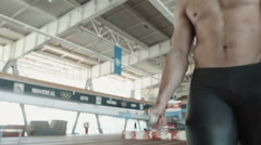 Javelin thrower training inside stadium Stock Footage