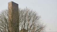 Medium Shot of medieval tower behind a tree in autumn in Pavia, PV, ITALY Stock Footage