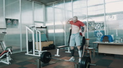 Olympic athlete lift heavy weight bar - stock footage