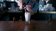 Barista whipping cream on a milk shake. 60 FPS slow motion shot - stock footage