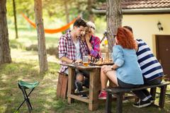 Lassie whisper to her boyfriend strategy for chess game Stock Photos
