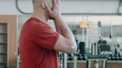 Tired athlete in gym looking around - stock footage