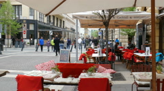 Budapest. Restaurant in city center and strolling tourists Stock Footage