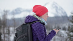 Young woman holding mobile smart phone with map gps navigation application HD Stock Footage