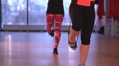 Two girls doing exercise in fitness room Stock Footage