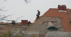 Roofers on a Top of Partly Repaired Roof Building Red Tiles Are Installed on Stock Footage
