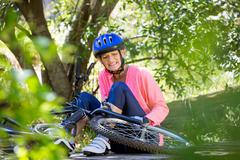 Senior woman is hurting because of her bike Stock Photos