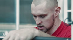 Very tired athlete near barbell bar breathing - stock footage