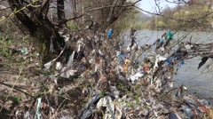 Rubbish on the river bank - stock footage