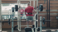 Olympic athlete lift heavy weight bar Stock Footage