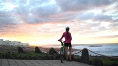 Stock Video Footage of Mountain Biking MTB Cyclist Woman Cycling on Bike Trail Relaxing Taking Break