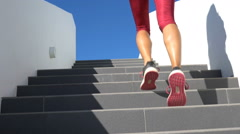 Running on stairs woman doing run up on staircase - female runner Arkistovideo