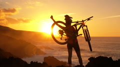 Success, achievement and accomplishment concept with MTB cyclist mountain biking Stock Footage