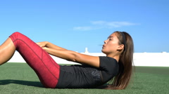 Sit-ups fitness woman doing situps crunches outside Stock Footage