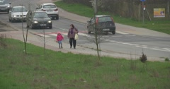 Day of Human Space Flight Opole Cityscape Cars Are Driven Grandmother and Kid Stock Footage