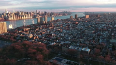 Northern NJ on the Hudson Flying Backwards Viewing Town, Manhattan and Park Stock Footage