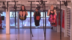 Three  girls doing exercise in fitness room Stock Footage