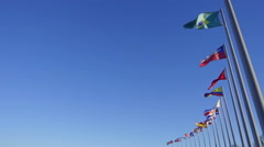 Slow motion of Few World Flags Used by the Wind over Blue Sky Stock Footage