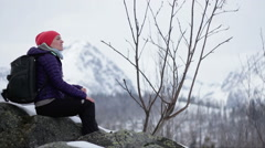 Young female tourist enjoying beautiful view in the mountains HD Stock Footage