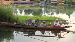 Local people in wooden boat, Srinagar, Dal lake, Jammu and Kashmir state, India Stock Footage