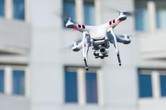 Hovering drone that takes pictures Stock Photos