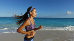 Fit Female Jogger Running On Perfect Beach - Healthy Active Lifestyle Stock Footage