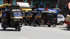 Indian people in a street during traffic . Srinagar, India Stock Footage