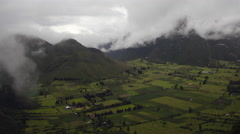 Stock Video Footage of Mist blowing over the crater of Pululahua Volcano, near Quito, Ecuador