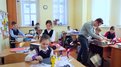 Children in the Class During the Art Lesson the Young Teacher. Caucasian, Stock Footage