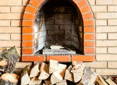 Not kindled brick fireplace and firewoods Stock Photos